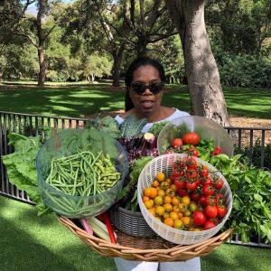 Oprah Winfrey shows off some harvest from her garden