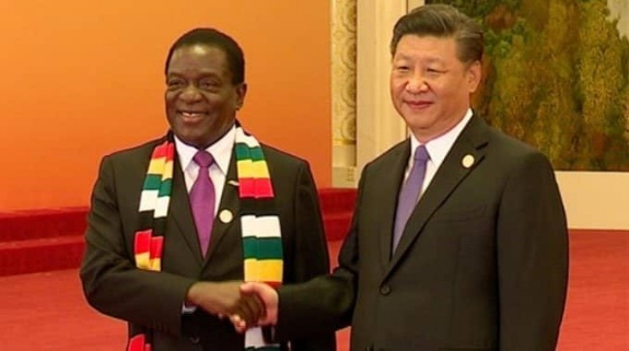 President Emmerson of Zimbabwe returns from China