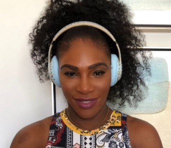 Serena Williams shows off her leopard skin designed headphones