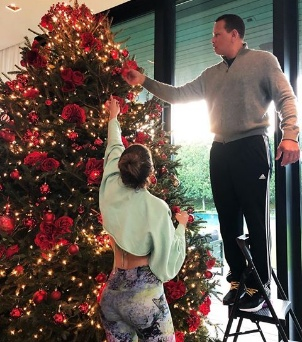 Jlo and her partner Rodriquez decorate Christmas tree with children