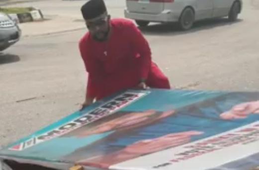 Bankole Wellington picks up his damaged billboards