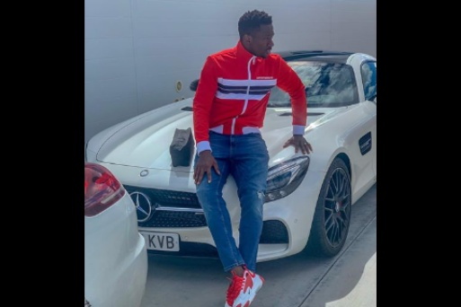 Eagles defender Kenneth Omeruo shows off his Mercedes Benz