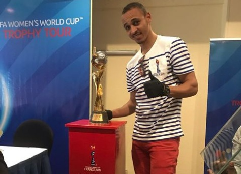 Osaze Odemwingie shows off the FIFA Women's World Cup trophy