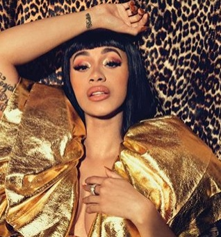 Cardi B calls off her concert due to plastic surgery complications