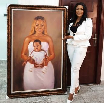 Linda Ikeji gifted with a giant self-portrait of her son and herself