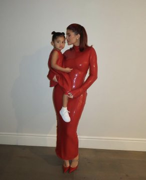 Kylie Jenner And Daughter Twinning In Red Outfit At Christmas Party